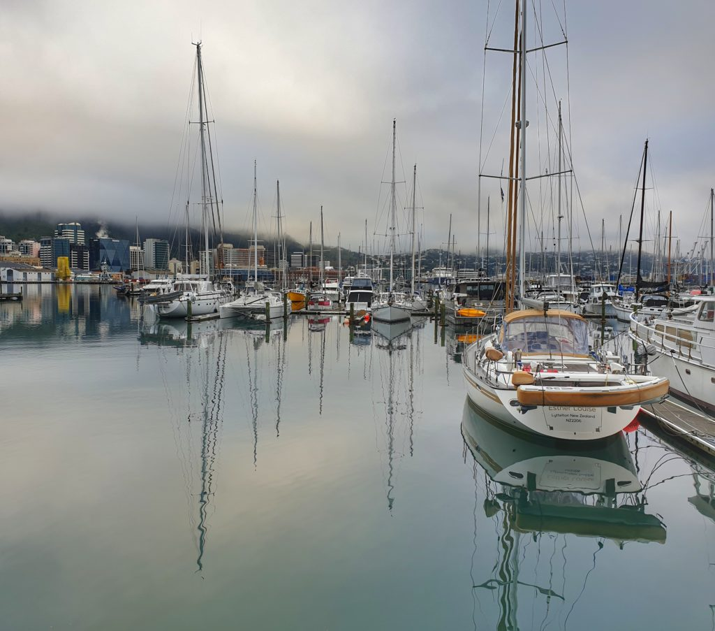 yachts and reflections in a glassy harbour