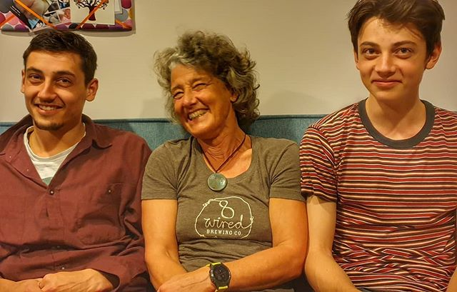 a Mum flanked by her two sons. Laughing