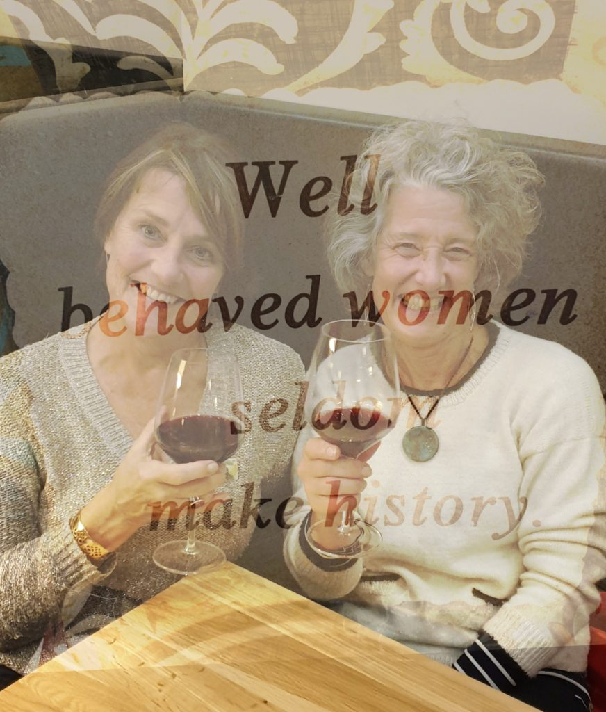 Two women in a restaurant with wine! Caption is Well behaved women seldom make history