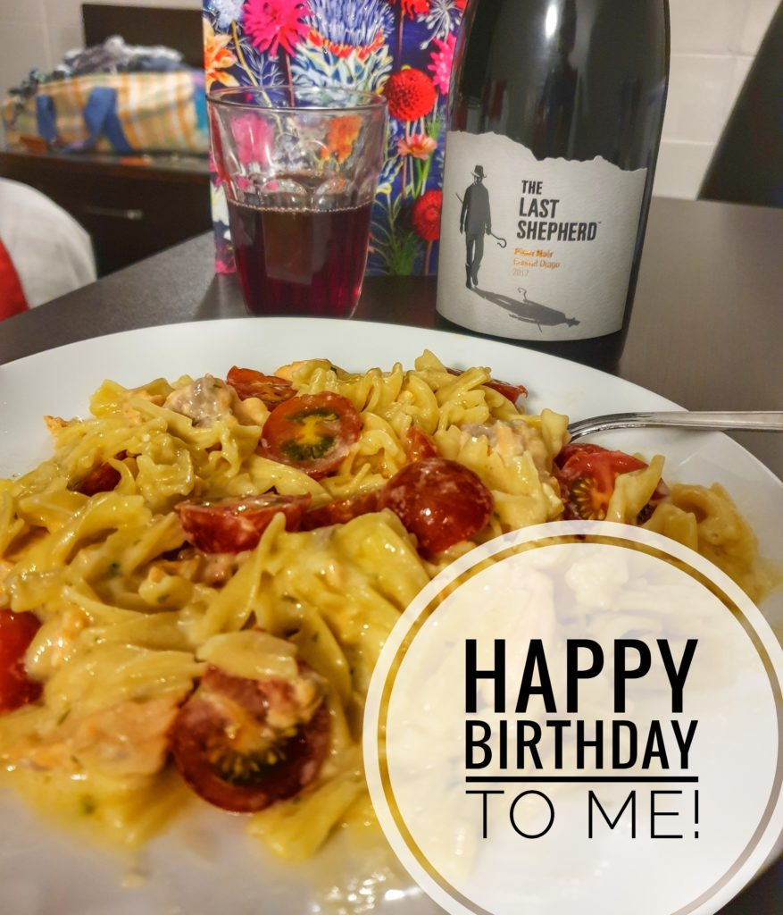 a plate of food, a bottle of wine -  a birthday meal