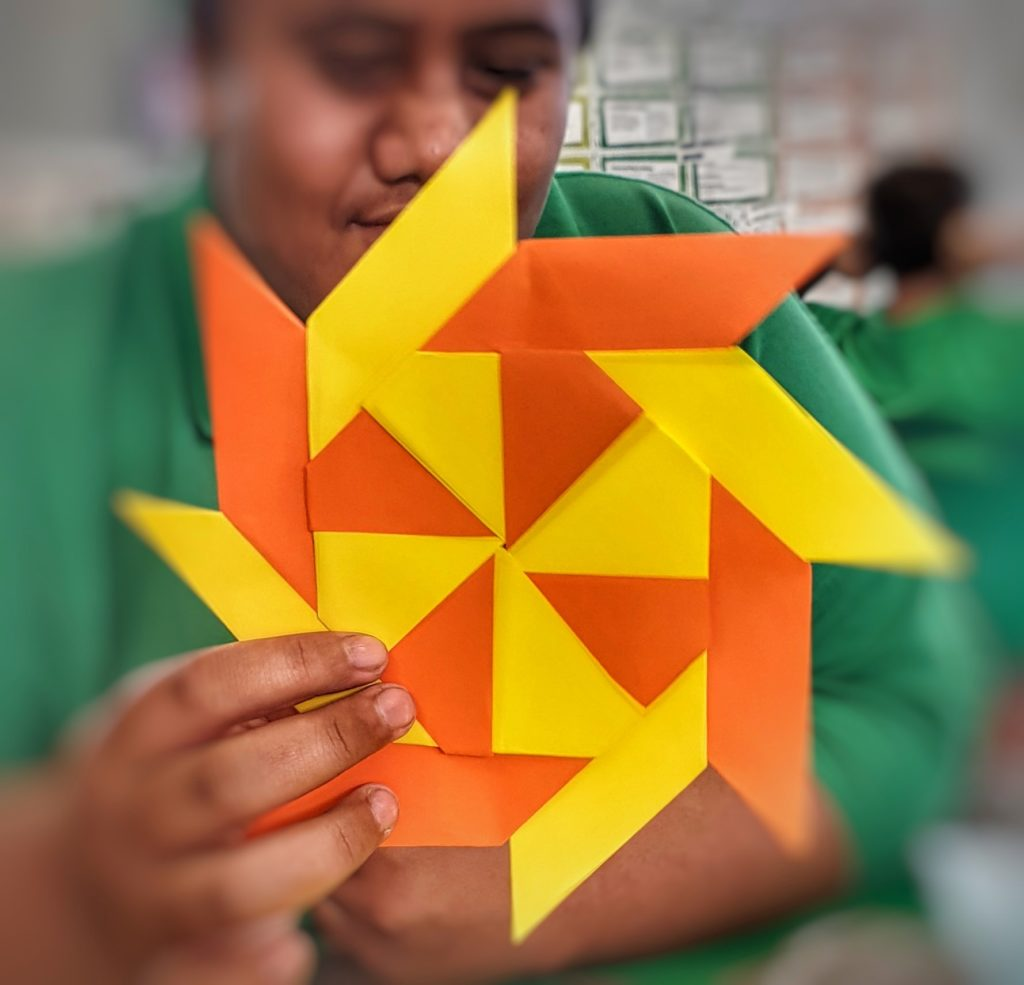 Boy holding a paper star
