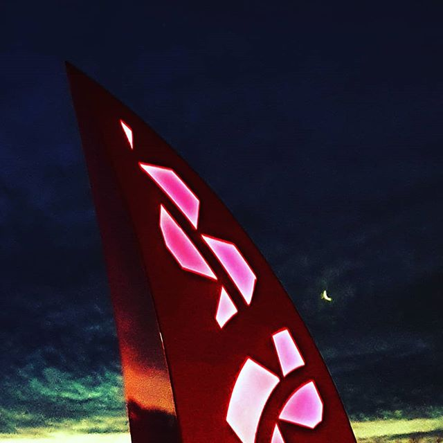 sculpture with māori symbols stands proud in the night sky