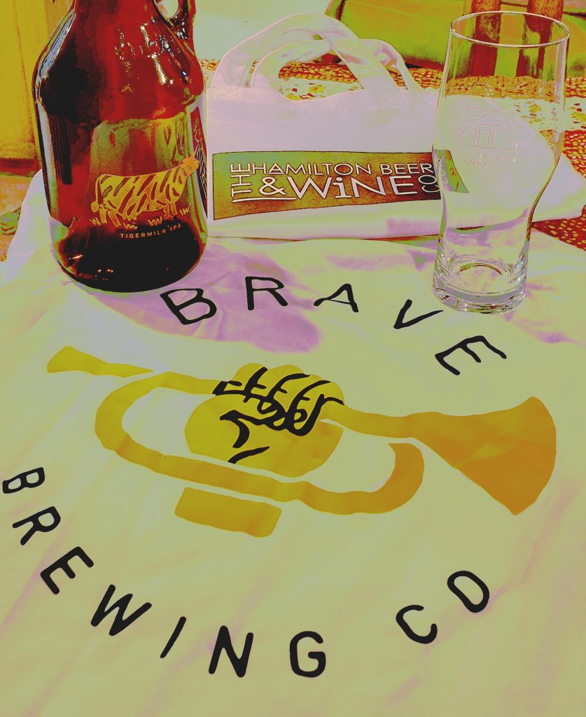 tee shirt, glass and bottle with Brave Brewing Company written on