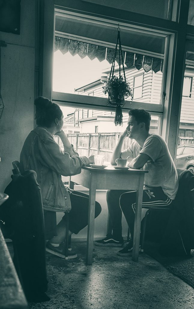 two people talk in a cafe