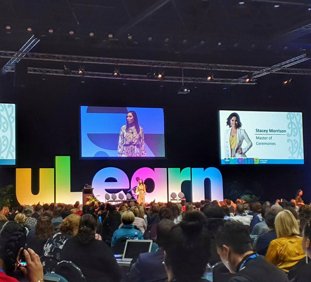 view of a stage at a conference with bright coloured large letters spelling uLearn